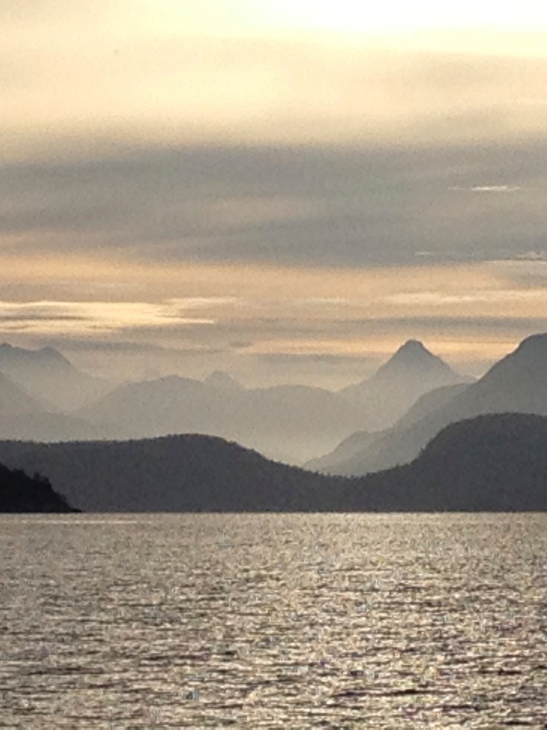 Golden glow of morning over Desolation Sound.